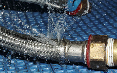 What happens when a flexible hose bursts?